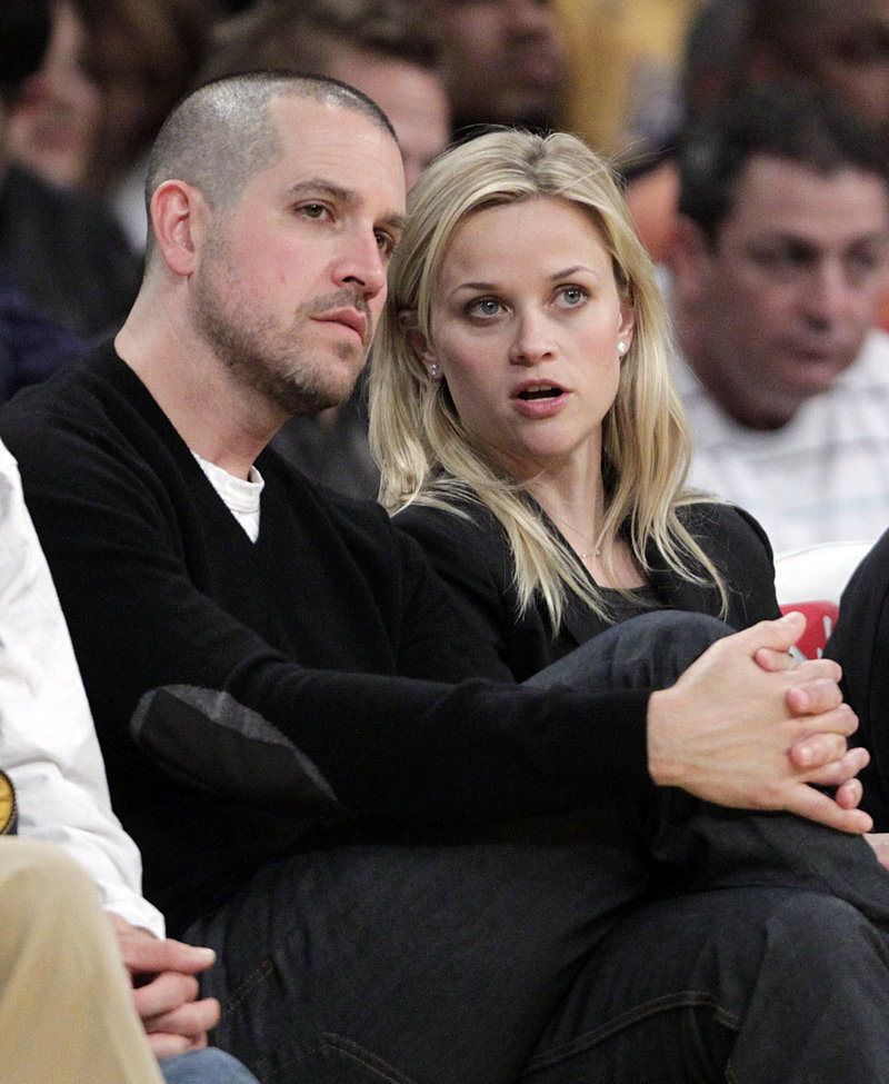 Actress Reese Witherspoon and her fiance, Jim Toth, watch an NBA basketball game between the Los Angeles Lakers and the Detroit Pistons in Los Angeles in January.