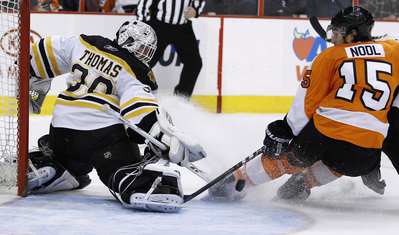 Tim Thomas blocks a shot from Philadelphia's Andreas Nodl during the second period of Sunday's 2-1 Boston win. Thomas stopped 27 shots and Brad Marchand scored with 3:43 left in the game for the Bruins, who moved within four points of second place in the Eastern Conference.