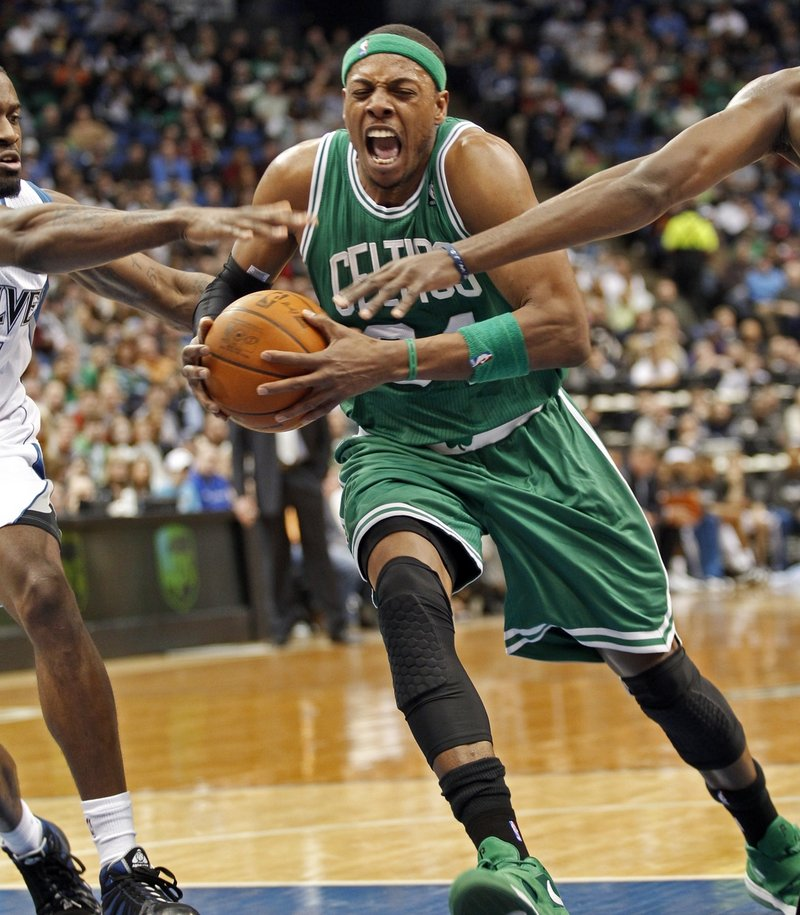 Paul Pierce drives the lane against a pair of Minnesota defenders during Boston's 85-82 win Sunday night. Pierce scored a pair of late baskets to help the Celtics.