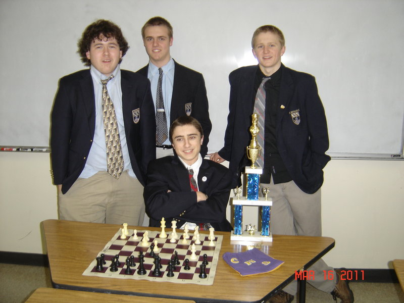 The Cheverus High School Chess Team includes, rear, from left, Cameron Prescott, Connor Mains, Pat Jerome; seated, Ethan Bergeron. Missing is Zachery Dulac.