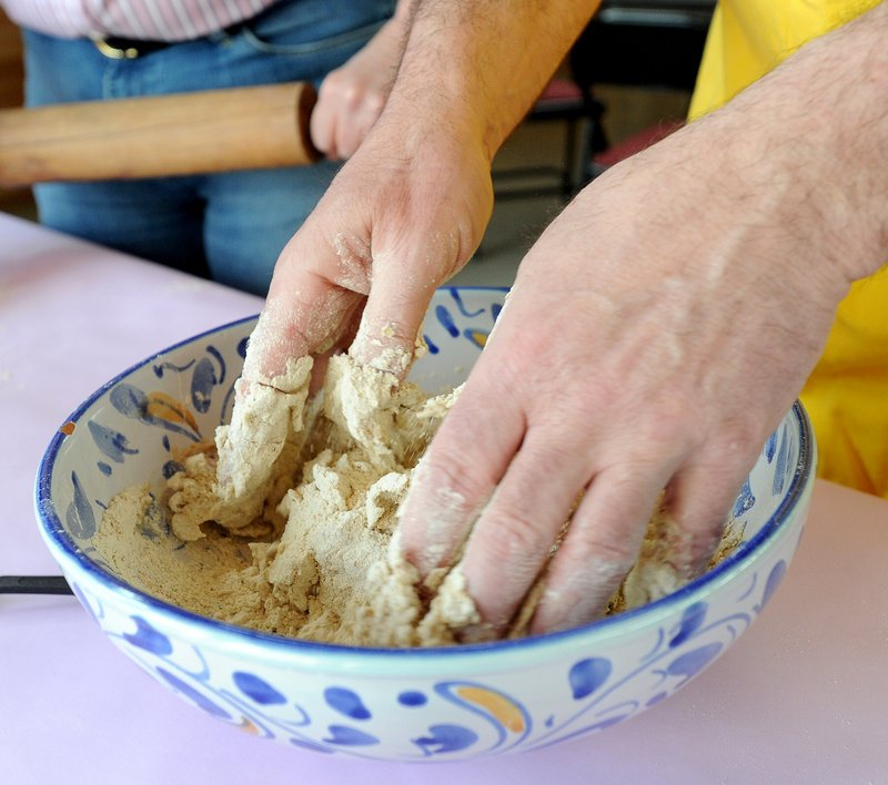 "Steve Steinbock mixes flour and water for a batch of matzah. Congregation Bet Ha'am hosts ""The Mystery of Matzah,"" a celebration of ancient grains, this weekend."