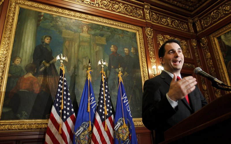 New Republican Gov. Scott Walker succeeded in having a law passed that nearly eliminates Wisconsin public employees' bargaining rights.