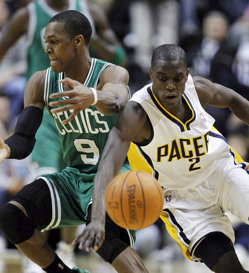 Darren Collison of the Pacers steals the ball from Boston guard Rajon Rondo in the second half of Indiana's 107-100 win Monday night in Indianapolis. Collison had 18 points and a pair of late buckets to keep the Pacers ahead.