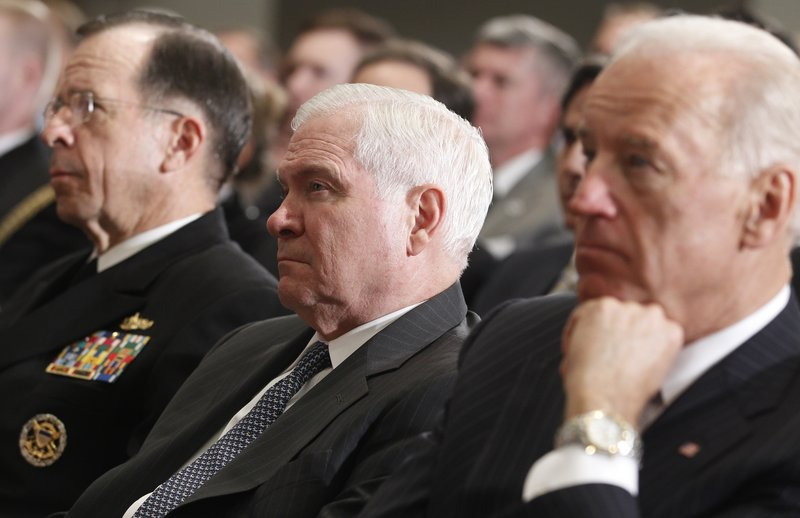 Defense Secretary Robert Gates, center, Chairman of the Joint Chiefs of Staff Adm. Michael Mullen, left, and Vice President Joe Biden listen to President Obama speak about Libya at the National Defense University on Monday.