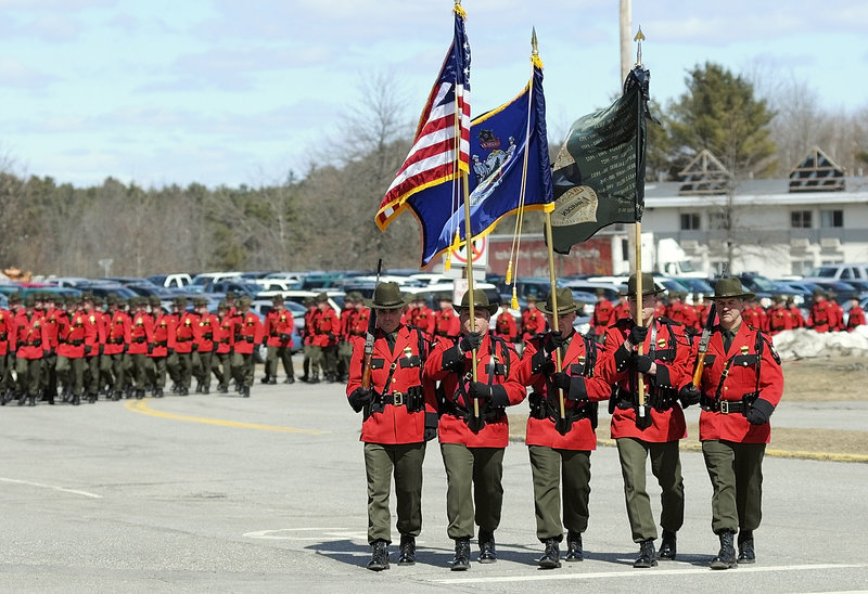 The Maine Warden Service color guard leads a procession of law enforcement officers at Wednesday's memorial service for warden service pilot Daryl Gordon at the Augusta Civic Center. He was the first game warden to die in the line of duty since 1992.