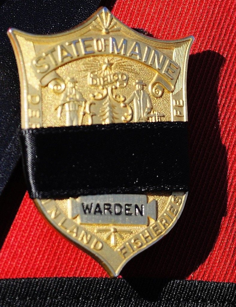"Warden service officers wore black bands on their badges to mark the loss of a member of their ""brotherhood."""