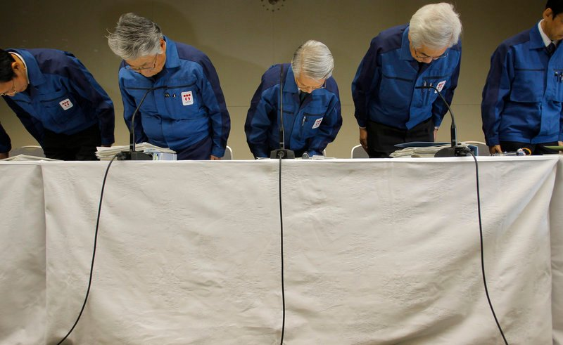 "Tokyo Electric Power Co. Chairman Tsunehisa Katsumata, center, expressed his ""deep apologies"" for the ""grave accident"" Wednesday. He is taking over daily operations after the company's president was hospitalized for stress."