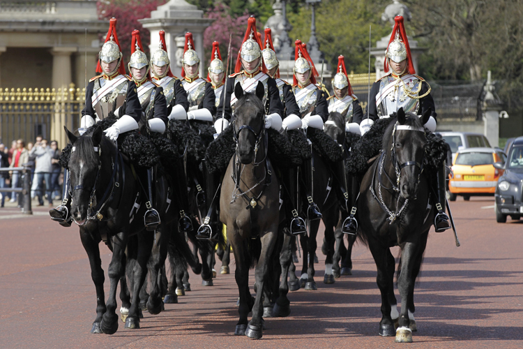 The Blues & Royals of the Household Cavalry Mounted Regiment ride past Buckingham Palace in London recently. The Blues & Royals together with the Life Guards will form a Sovereign's Escort for Queen Elizabeth II and a Captain's Escort for the bride and groom from Westminster Abbey to Buckingham Palace during the royal wedding of Prince William and Kate Middleton on Friday.