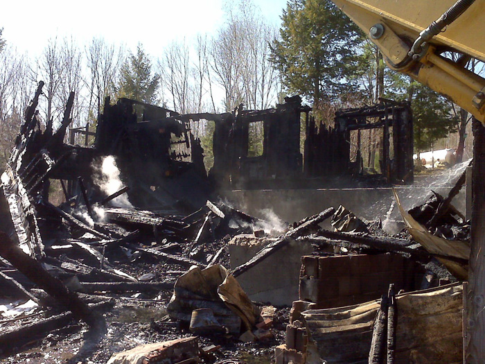 Scenes of this morning's fire at 254 Highland Park Road in Fryeburg.