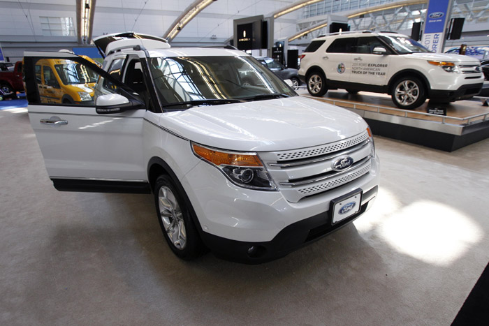 Ford Motor Co. says it earned $2.6 billion in the first quarter, helped by vehicles like the 2011 Explorer, shown here at the Pittsburgh International Auto Show in February.