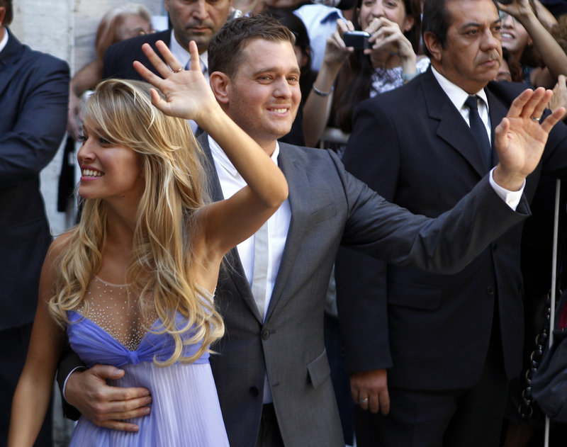 Pop star Michael Buble and his new wife, Luisana Lopilato, wave to fans after their civil wedding ceremony in Buenos Aires on Thursday.