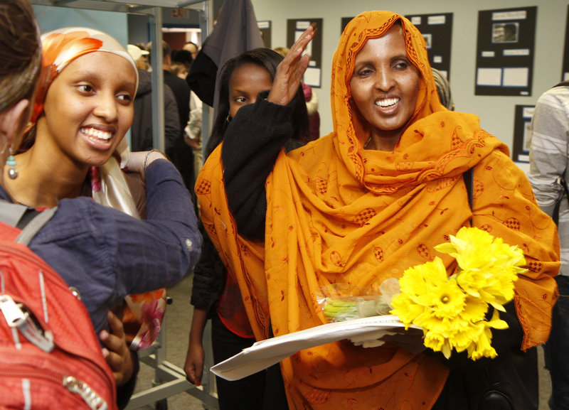 Casco Bay High School sophomore Hido Abdulleh, left, and her mother Ruun Ali celebrate after Ali was naturalized.