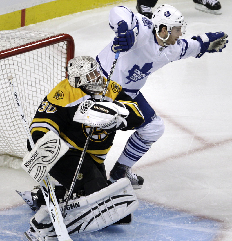 Bruins goalie Tim Thomas grabs the stick of Toronto left wing Darryl Boyce during the Maple Leafs' shootout win.