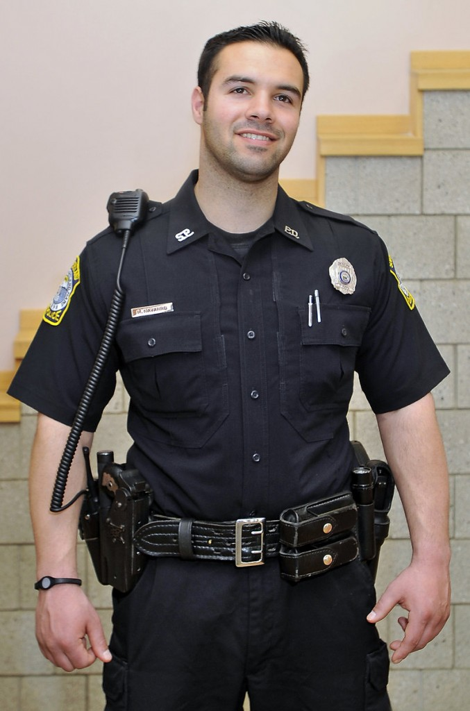 South Portland police Officer Rocco Navarro models his utility belt. Gone are the days when officers simply carried a service revolver, night stick and handcuffs.