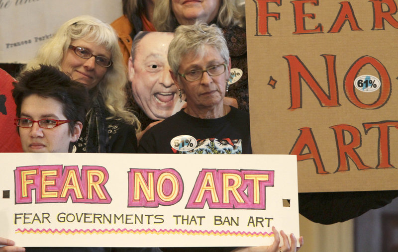 Demonstrators rally Monday at the State House, demanding the return of the mural that Gov. Paul LePage ordered removed from the Maine Department of Labor headquarters.
