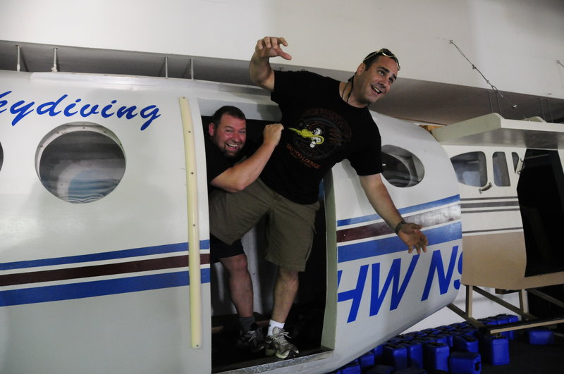 Listen Up Español co-founders Craig Handley, left, and Tony Ricciardi ham it up after skydiving from a plane above Memphis. They belong to a membership company that organizes thrilling networking and team-building trips.