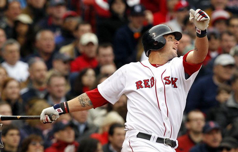 Jarrod Saltalamacchia hits a double in the fifth inning Friday afternoon at Fenway Park, scoring Kevin Youkilis and breaking a 6-6 tie against the New York Yankees. It was just the second hit of the year for the Red Sox catcher.