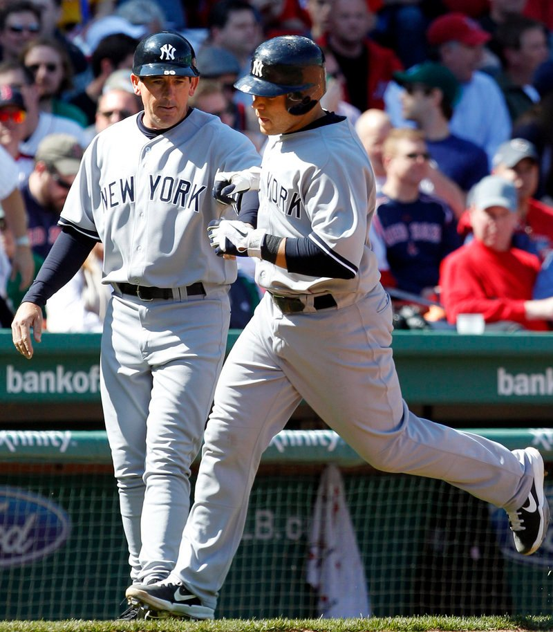 Russell Martin, who chose the Yankees over the Red Sox during the winter, is greeted by third-base coach Rob Thomson after hitting a three-run homer in the fourth inning Saturday.