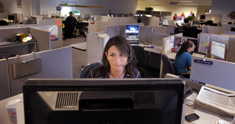 Holly Morse, a customer service representative, talks with a customer in the call center at Wright Express.