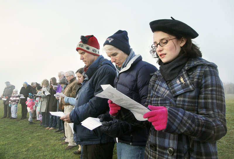 Sally Keiter of South Portland sings hymns with her parents, Betsy and Chris.