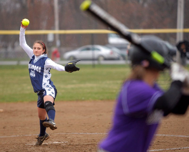 Portland's Cassandra Kennie winds up and delivers a pitch to a Deering batter on Monday afternoon at Payson Park in Portland. Deering's Caley Presby had a three-run homer among her three hits to lead the host Rams to a season-opening victory over the Bulldogs, 14-6.