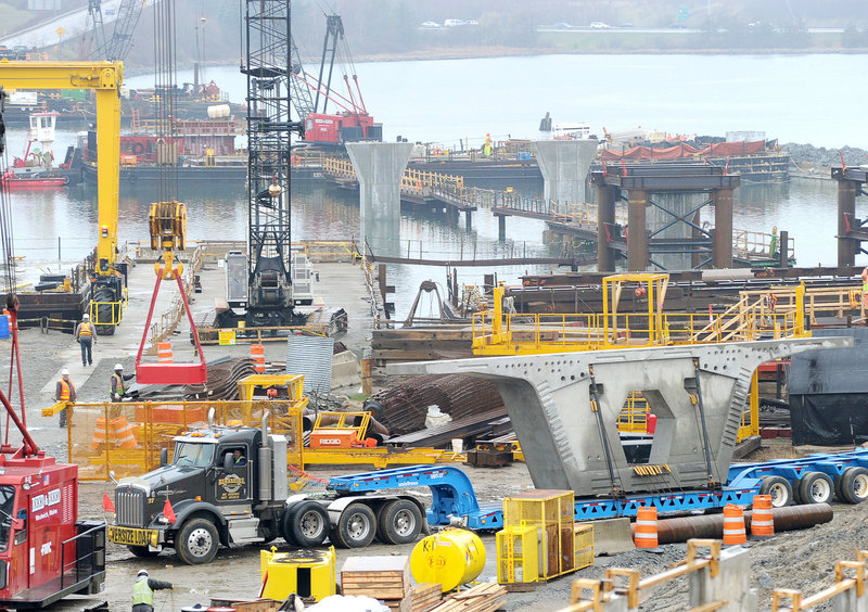 A tractor-trailer delivers a segment of the new Veteran Memorial Bridge to the worksite along the Fore River in Portland on Tuesday.