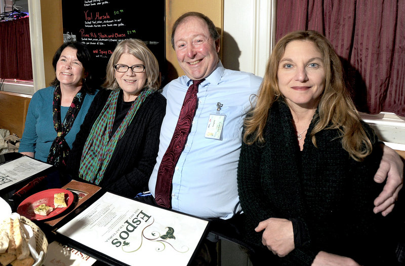 Greg Morin sits with Eileen Delaney, Helen Peake-Godin and Jeanette Andonian at Espo's in Portland on Tuesday. The three women called 911 and did CPR on Morin when he had a heart attack at USM in 2006.