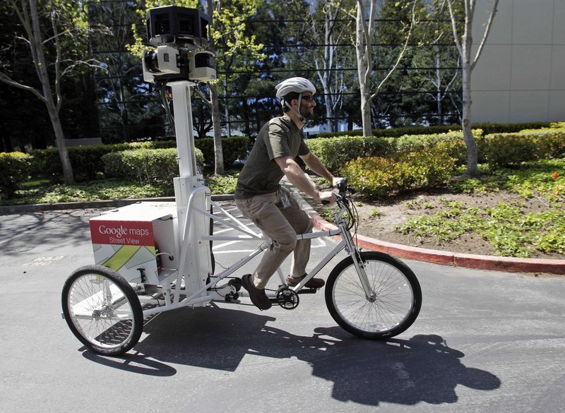 Daniel Ratner, a mechanical engineer, demonstrates the StreetView Trike used by Google for street mapping. Ratner built the prototype in a machine shop created for employees.