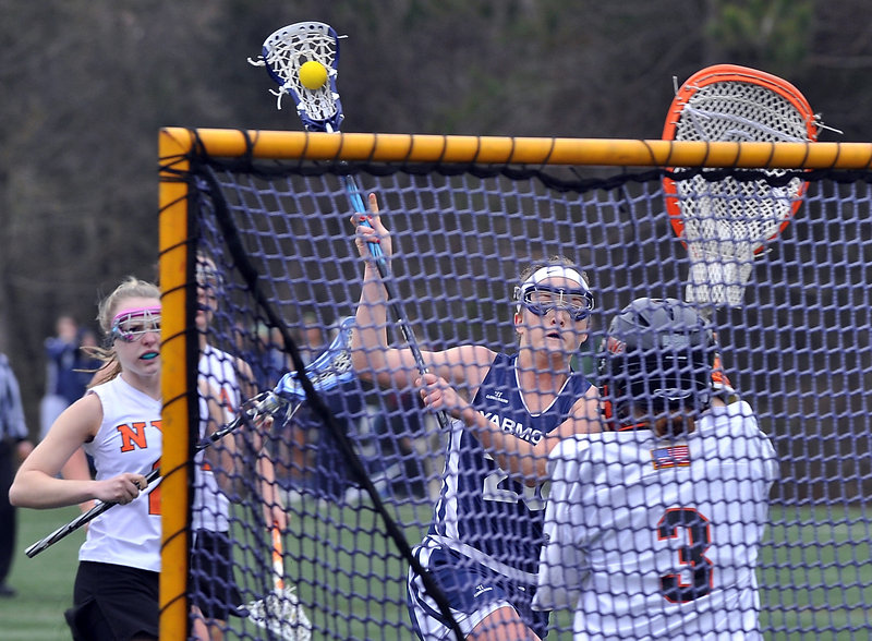 Becca Bell of Yarmouth lines up a shot for one of her seven goals Tuesday during a 16-9 victory against North Yarmouth Academy in girls' lacrosse. The NYA goalie is Frances Leslie.