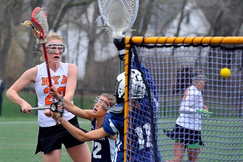 Kate Dilworth and goalie Stephanie Moulton of Yarmouth combine to knock away a second-half shot by Lilly Wellenbach of North Yarmouth Academy.