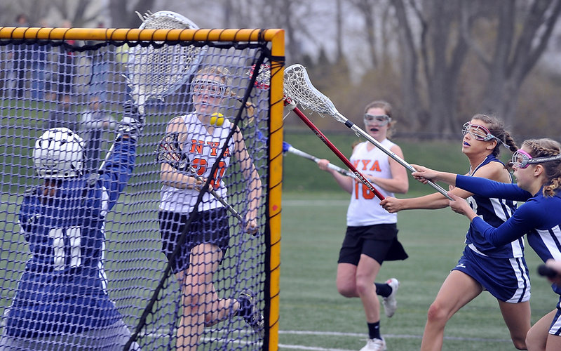 Lilly Wellenbach of NYA breaks away Tuesday for one of her three goals in the 16-9 loss to Yarmouth. The Yarmouth goalie is Stephanie Moulton as defenders Kate Dilworth and Olivia Harrison move in. No. 16 for NYA is Katie Cawley.