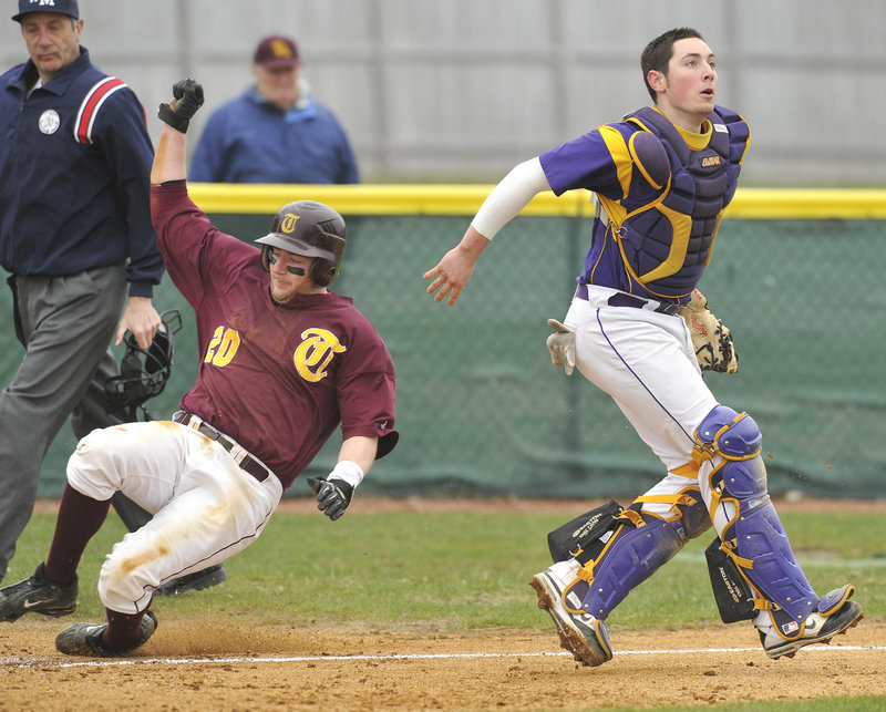 Fred Randall of Thornton Academy crosses the plate as Cheverus catcher Nic Lops prepares to grab the late throw in the second inning.