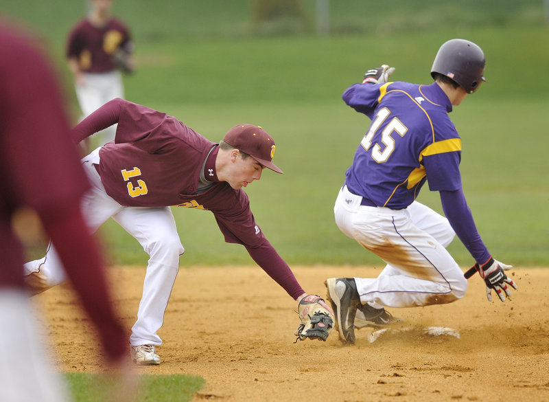 Louis DiStasio of Cheverus beats a tag from Thornton Academy shortstop Sam Canales to steal second base Wednesday in the first inning of Cheverus 5-4 victory at Cheverus High. The Stags are 2-0; Thornton is 1-1.
