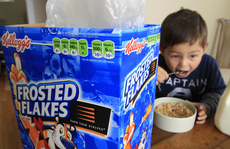 Four-year-old Nathaniel Donaker eats Kellogg's Frosted Flakes in Palo Alto, Calif. Commercials promoting sugary breakfast cereals could fall under government guidelines urging food companies to limit marketing of unhealthy products to children.