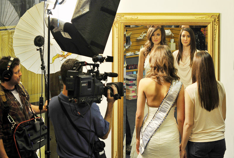 "A camera crew films former Miss Maine USA Emily Johnson, left, and her sister, Crystal Johnson, right, at Andrea's Bridal Shop on Congress St. in Portland Thursday for a segment on ""Inside Edition."" Emily Johnson withdrew from the pageant after finding out it conflicted with her sister's wedding."