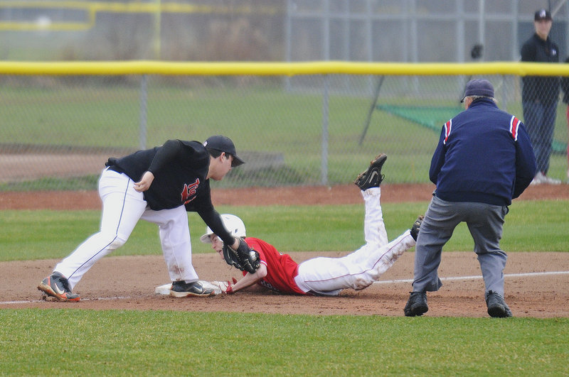 Will Bushey of South Portland slides safely into third base with a triple Thursday as Nate McKeown of Biddeford applies the late tag during South Portland's 11-1 victory in a Telegram League baseball game at home. Each team has a 2-1 record.