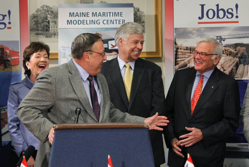 Gov. Paul LePage, at podium, jokes with American Bureau of Shipping chairman Robert Somerville, far right, Thursday during a news conference. Maine's Sen. Susan Collins and Rep. Michael Michaud look on.