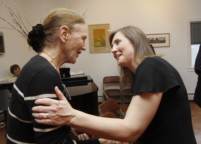 Denise Wilson, right, of Counseling Services Inc. congratulates Millicent Monks after Monks was honored for speaking out about mental illness.