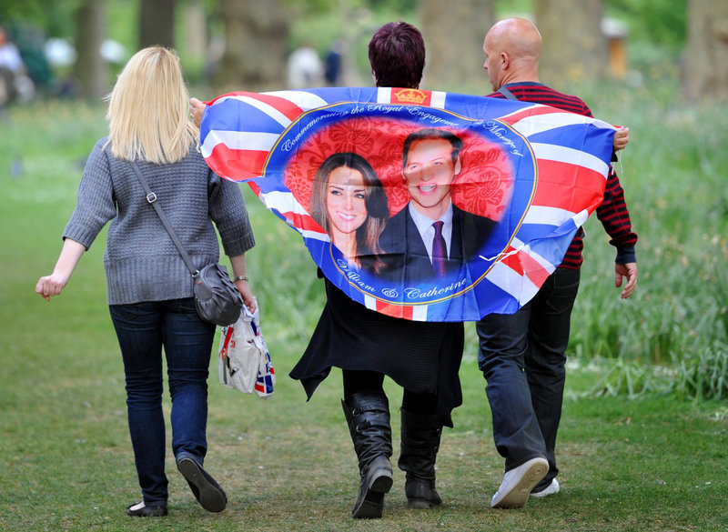In St. James's Park, the oldest of London's royal parks, people carry reminders Thursday of today's wedding of Prince William and Kate Middleton.