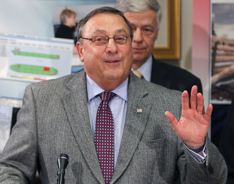 Gov. Paul LePage talks about the departure of Phil Congdon as commissioner of economic and community development during a news conference Thursday at the State House in Augusta.