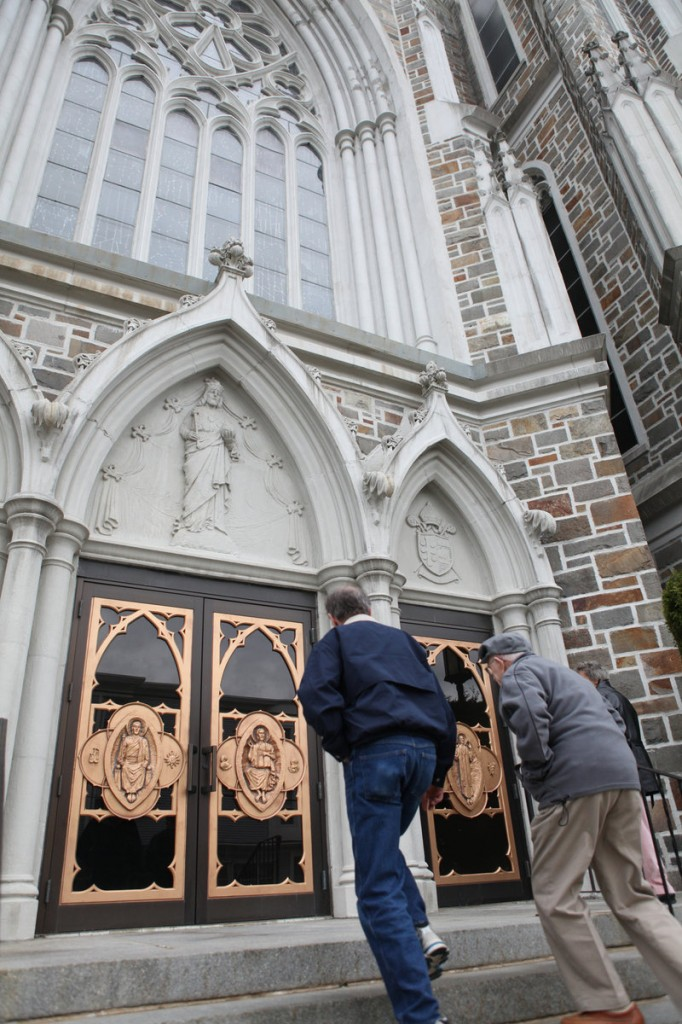 Brian LeBlanc of Lunenburg, Mass., and his father, Leo, of Leominster, enter St. Cecilia Church in Leominster, Mass. The Archdiocese of Boston launched an ad campaign during Lent to encourage parishioners to come to church.