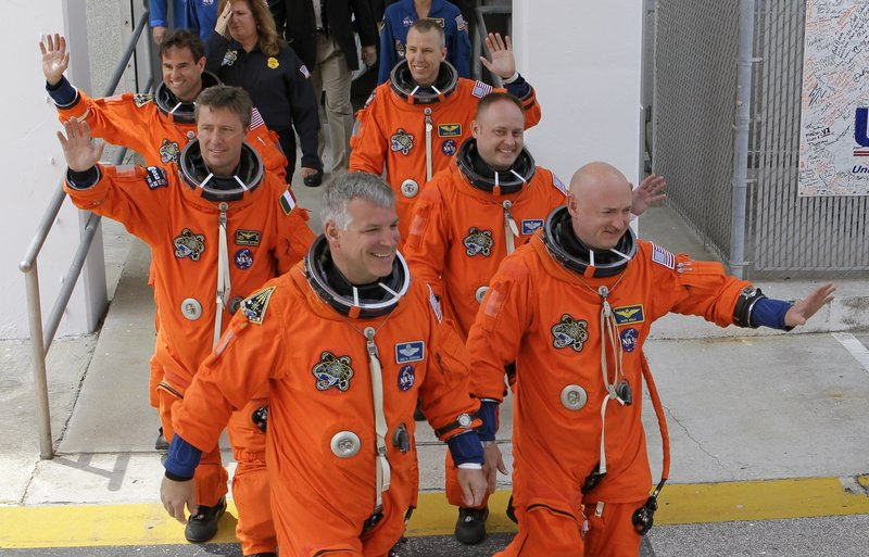The crew of space shuttle Endeavour, seen Friday boarding at Kennedy Space Center in Cape Canaveral, Florida, includes mission commander Mark Kelly, right. Kelly is the husband of Sen. Gabrielle Giffords, who is recovering from a gunshot wound but made the trip from a Houston hospital. The launch, however, was eventually scrubbed because of technical problems. The historic mission is the last for the Endeavour shuttle, and the next-to-last for the shuttle program.