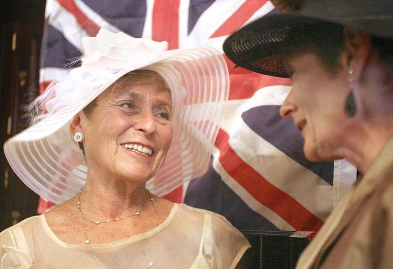 Merle Nelson of Falmouth, left, and Lennie Burke of Brunswick visit during a black tie formal party at the Cumberland Club in Portland on Friday to celebrate the royal wedding of William and Kate.