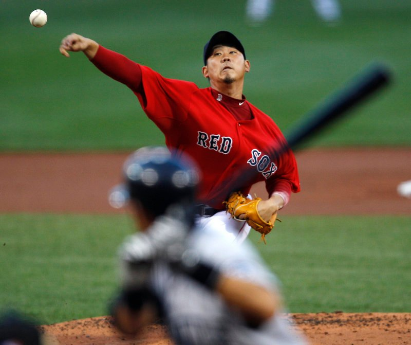 Daisuke Matsuzaka struck out four and allowed three hits and four walks before leaving in the fifth inning with tightness in his right elbow Friday night at Fenway Park.
