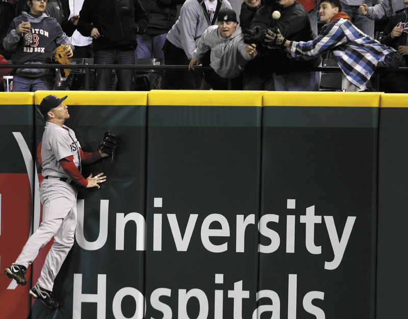 Boston Red Sox right fielder J.D. Drew jumps high but cannot reach a three-run home run hit by Cleveland Indians' Asdrubal Cabrera in Wednesday's game in Cleveland. It was the fifth in what has become a six-game losing streak. The winless Sox host the Yankees today in their home opener.