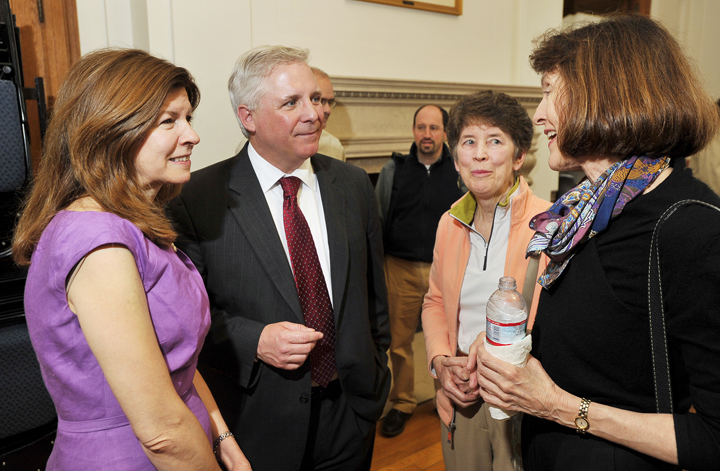 Beth and Mark Rees, on left, talk with Sally Oldham and Hilary Bassett from Greater Portland Landmarks at a reception last Friday in the State of Maine Room at Portland City Hall.