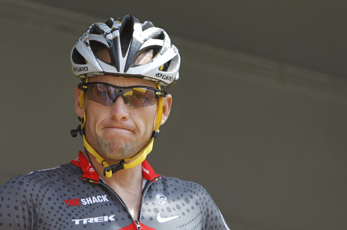 Lance Armstrong grimaces prior to the start of the third stage of the Tour de France cycling race in Wanze, Belgium, in this July 6, 2010, photo.