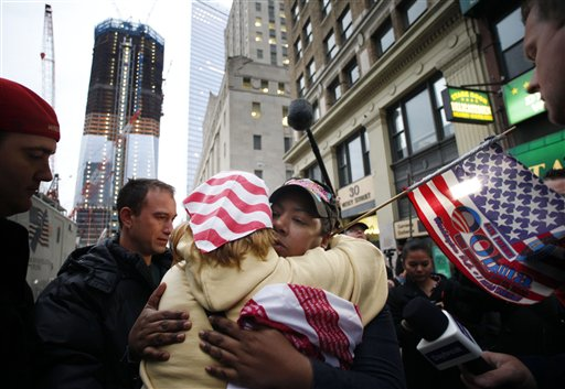 Dionne Layne, facing camera, hugs Mary Power as they react to the news of the death of Osama bin Laden today in New York. At left is the rising tower, 1 World Trade Center, also known as the Freedom Tower.