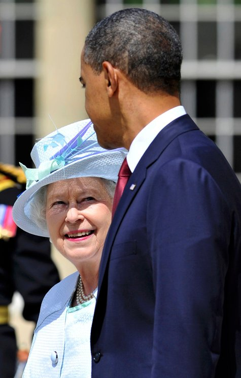 President Barack Obama and Queen Elizabeth attend the ceremony for the national anthems at Buckingham Palace in London today.