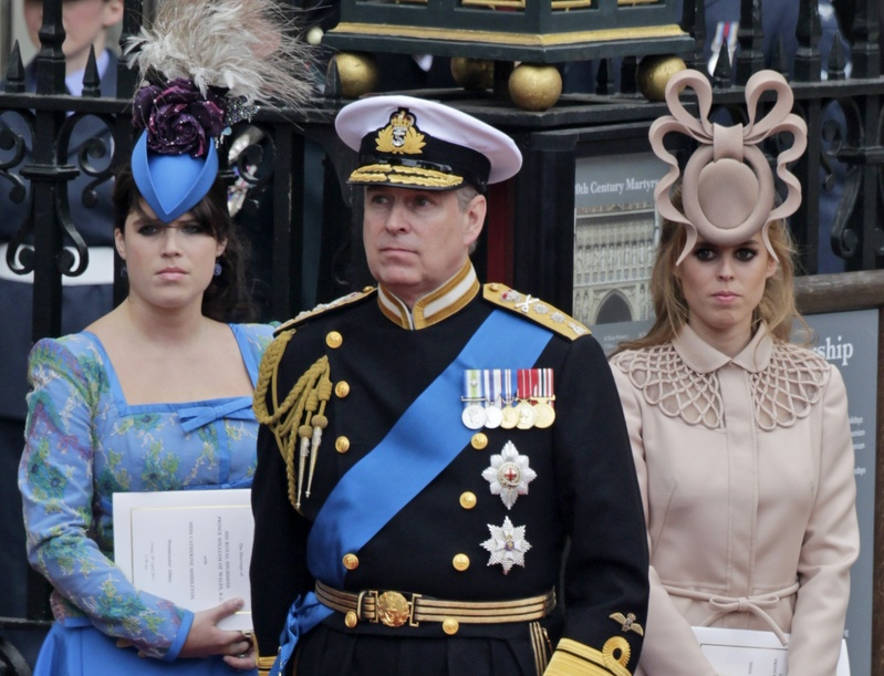 Britain's Prince Andrew, center, and his daughters Princess Eugenie, left, and Princess Beatrice leave Westminster Abbey at the Royal Wedding in London. The hat worn by Princess Beatrice was auctioned to raise money for charity.